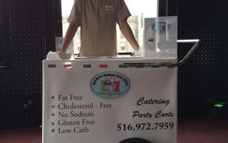 Employee at ice cream freezer